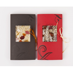 Chocolate bars with dried fruits, nuts and almonds