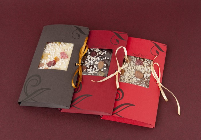Chocolate bars with dried fruits and nuts
